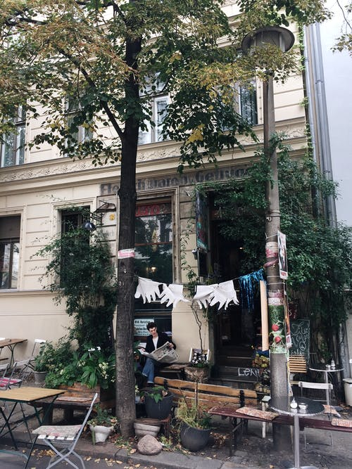 Gloves Hanged on Tree Near Building