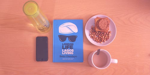 Peanuts and Biscuits in White Ceramic Plate Beside White Ceramic Mug Near Lagos Living Book