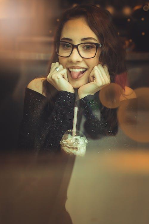 Woman In Black Off-shoulder Shirt And Black Framed Eyeglasses