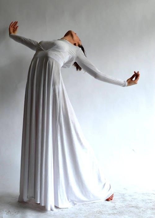 Woman Wearing White Long-sleeve Dress