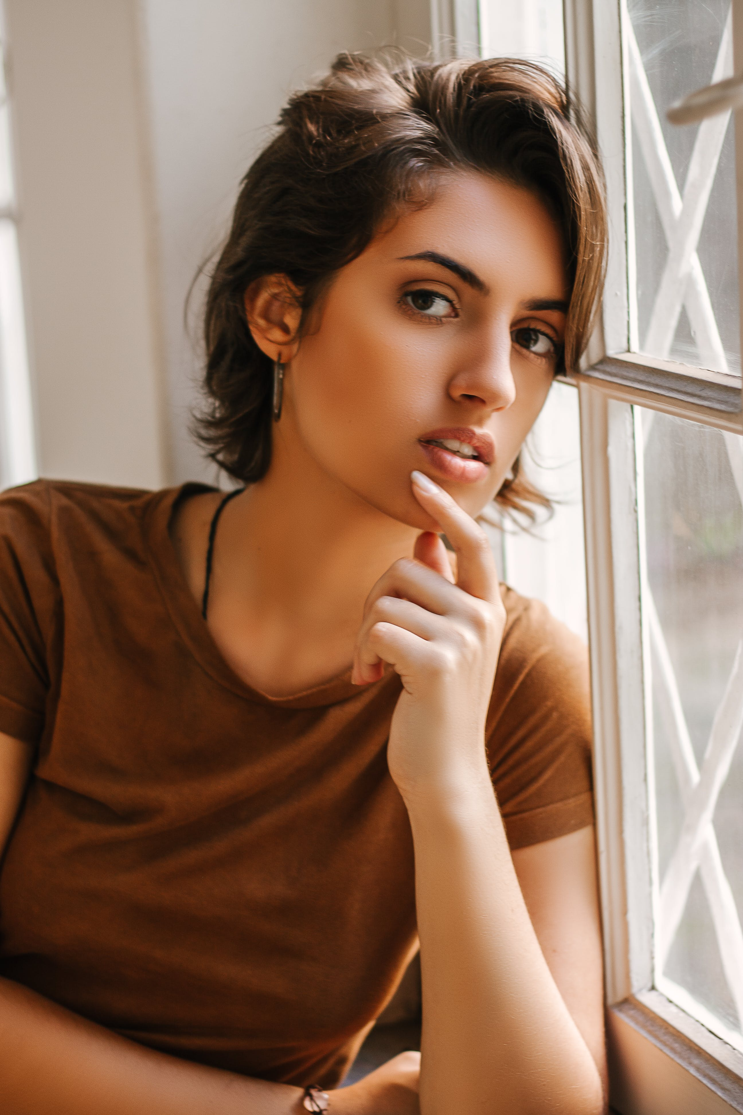 Close-up Photo of Woman Leaning on Window