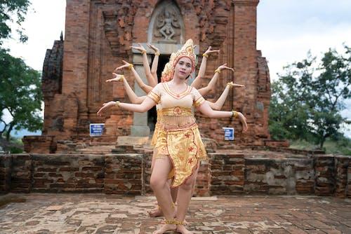 People Dancing Beside Concrete Temple