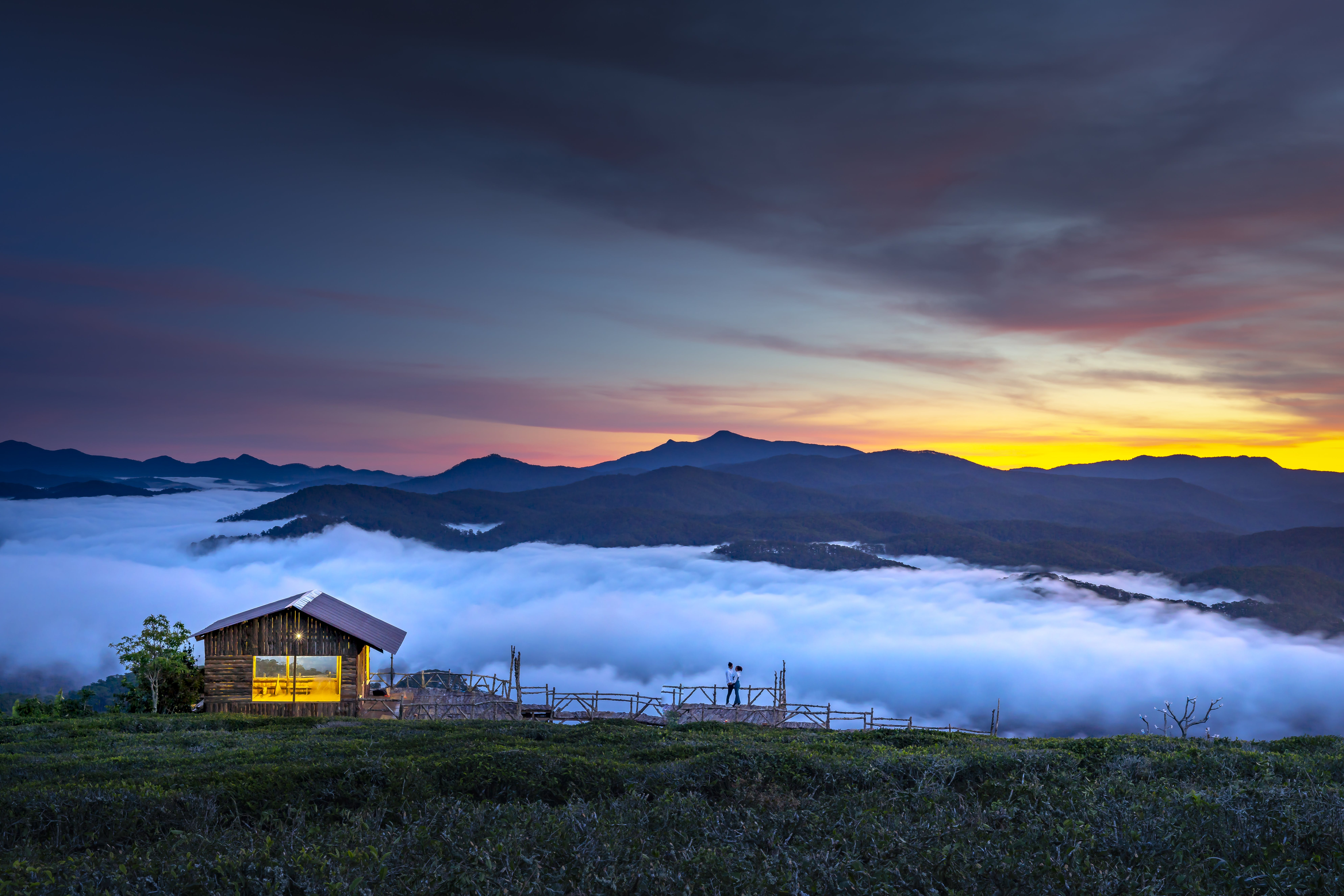 Brown Wooden Cottage With View Of Clouds And Mountain