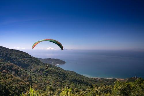 Parachuting Man Above Mountain