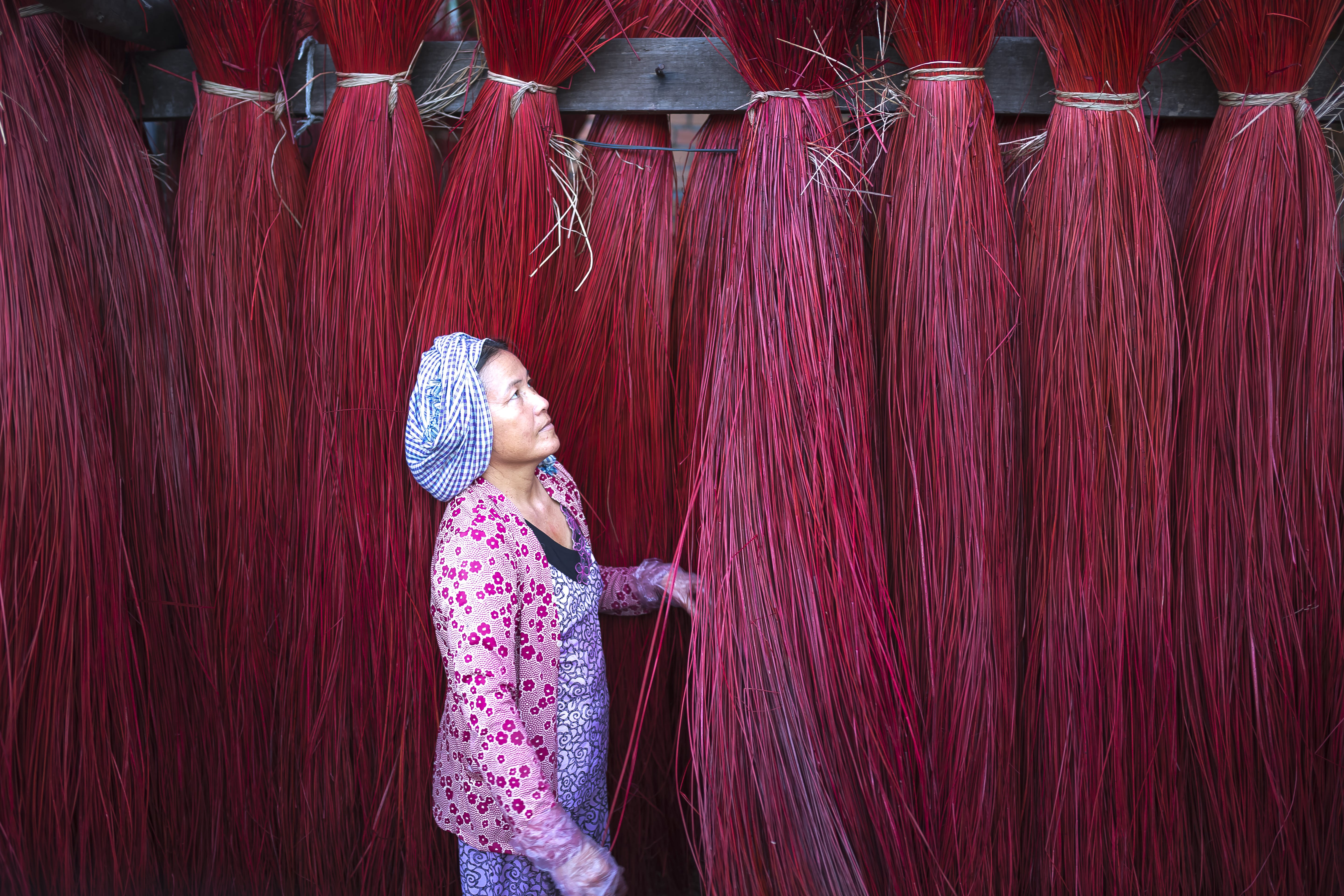 Woman Standing Beside Red Strings