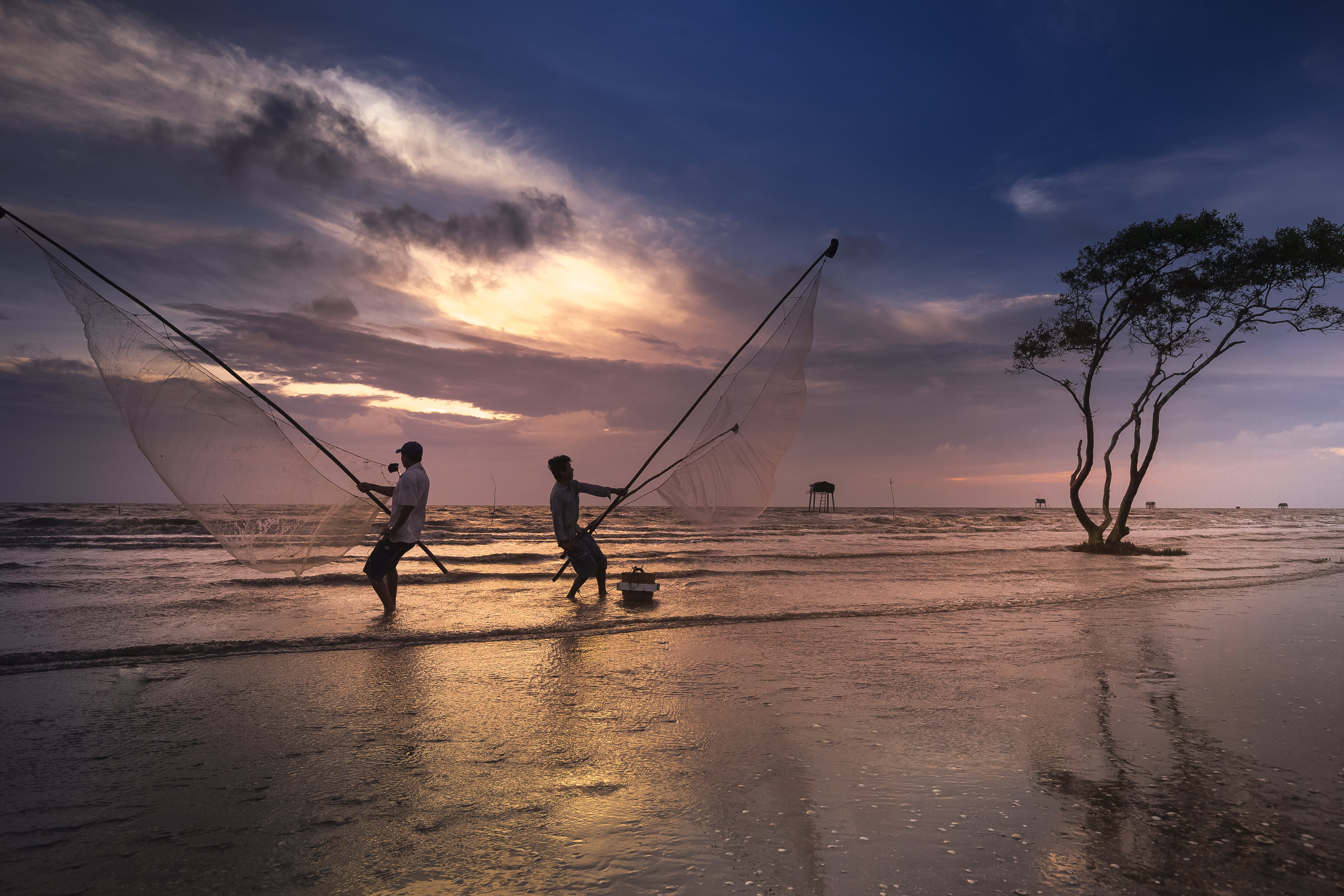 Two Men Holding Nets