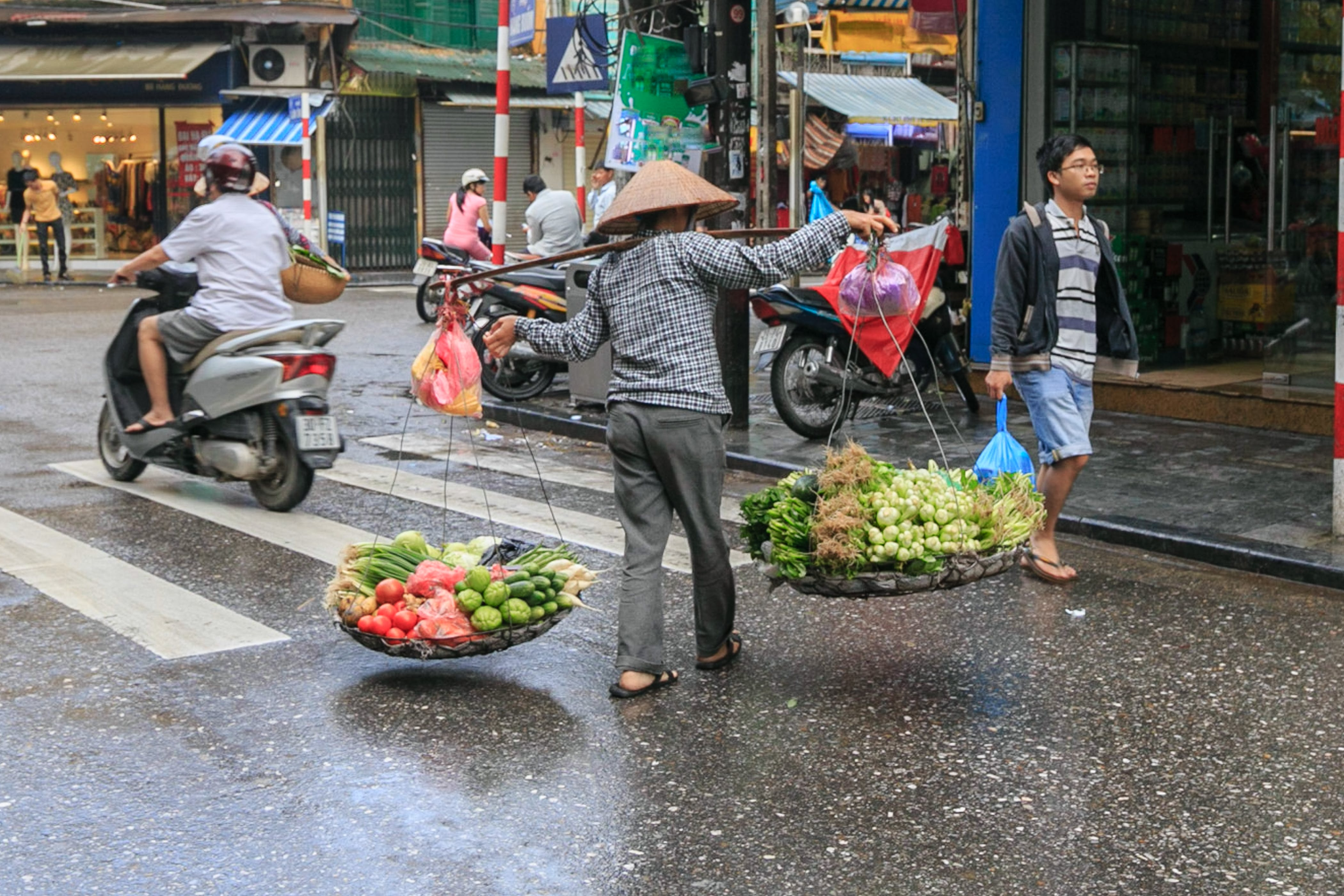 Person Carrying Vegetables Passing on Road