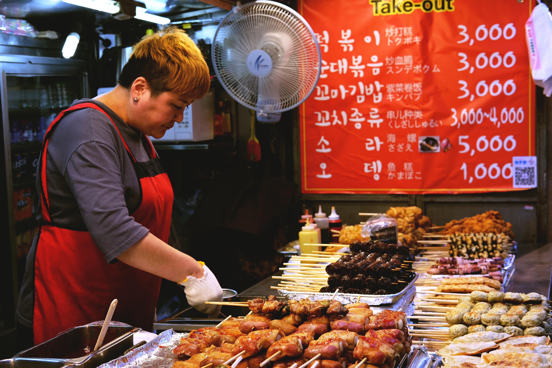 Woman Wearing Red Apron Preparing Food