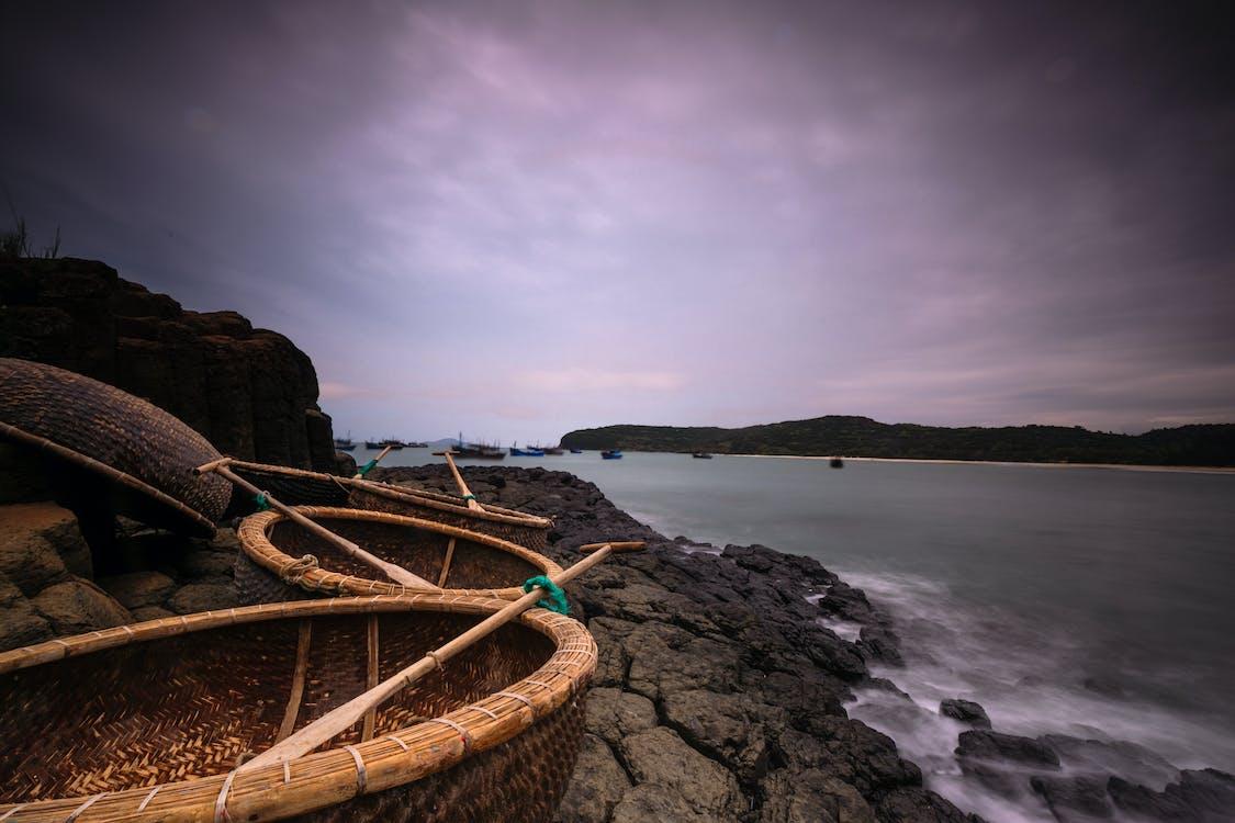 Three Brown Baskets Beside Beach