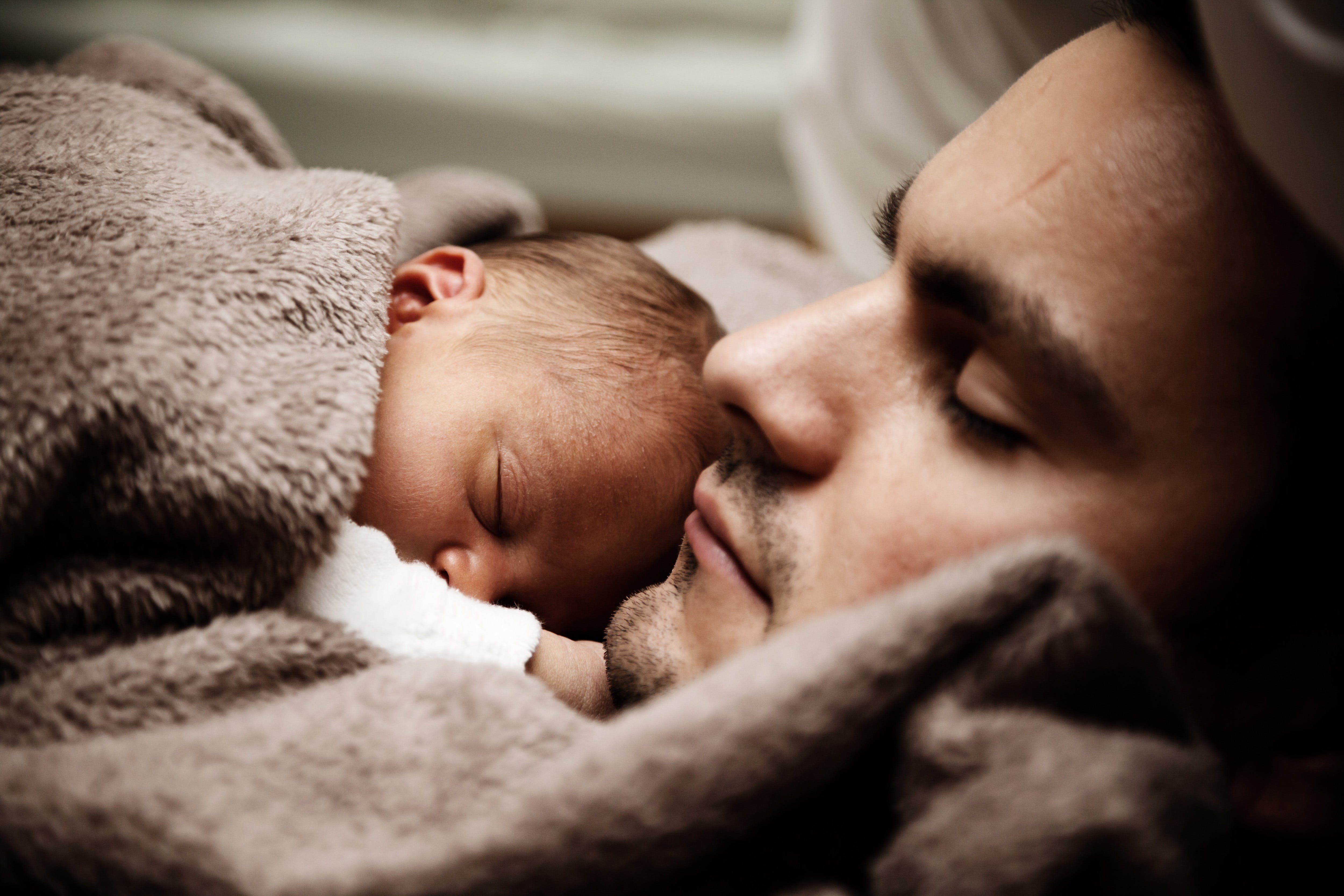 Sleeping Man and Baby in Close-up Photography