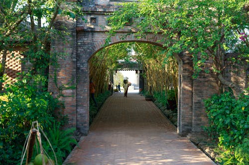 Walkway With Arched Brick Wall