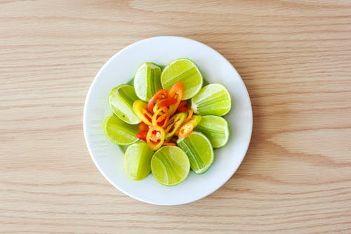 Green Fruit Slices on Plate