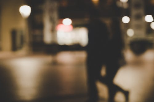 Blur Image Of A Couple Walking In The Street
