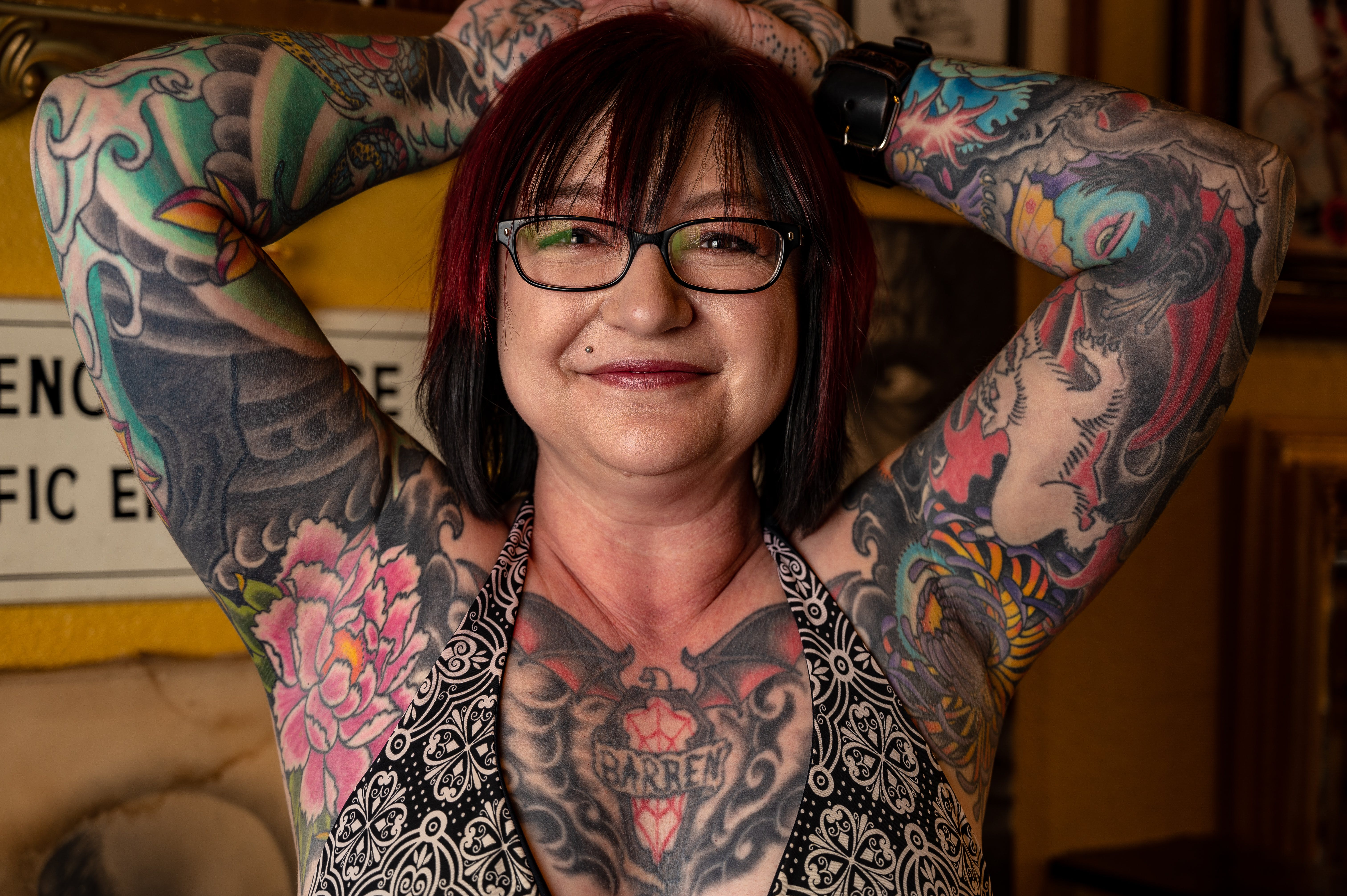 Woman With Tattoo Covered Body Wearing Bra