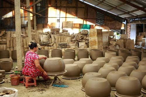 Woman Making Pots