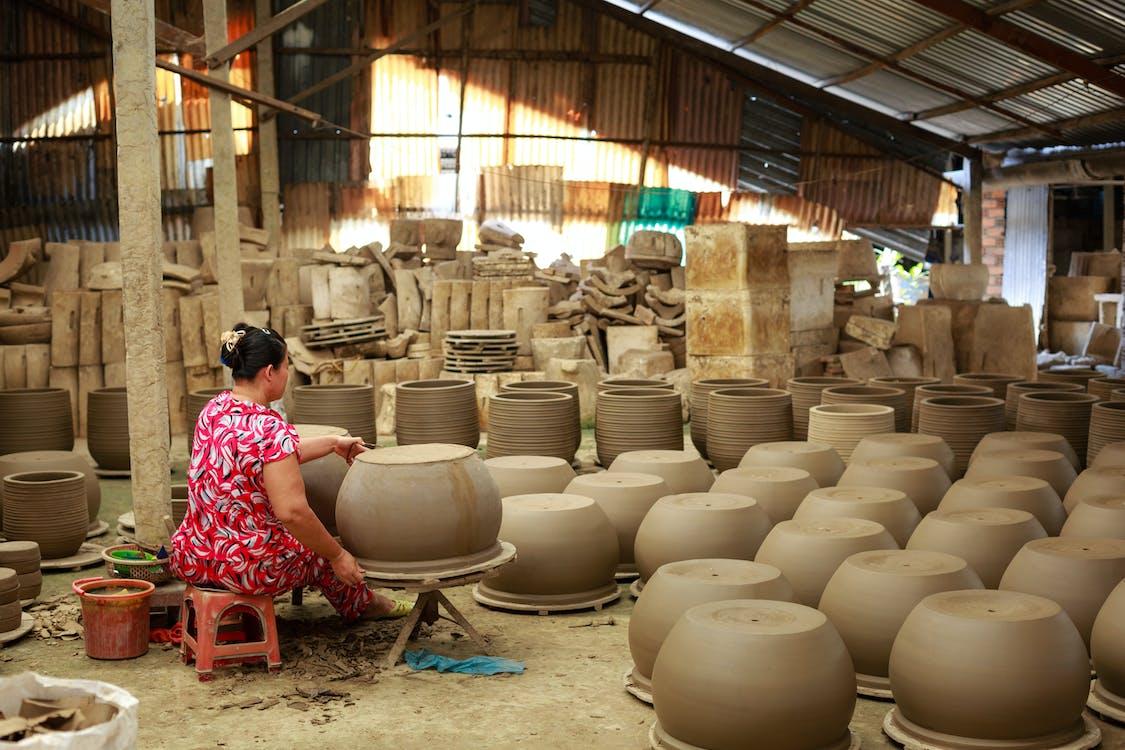 Woman Making Pots