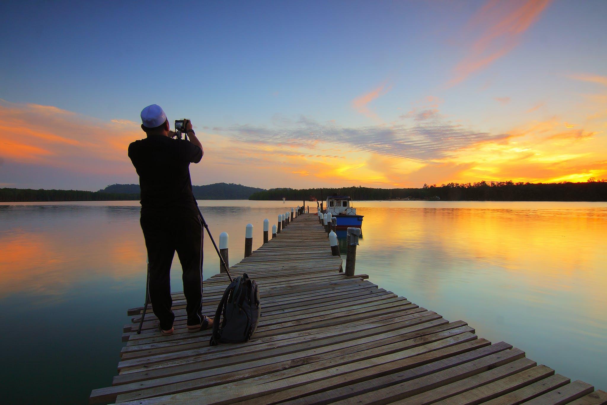 Foto profissional grátis de água, alvorecer, barco, cais