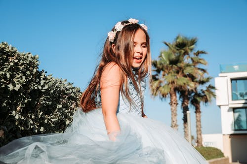 Smiling Girl Wearing White Tulle Dress