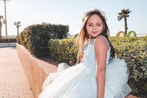 Photo Of A Girl Wearing White Dress