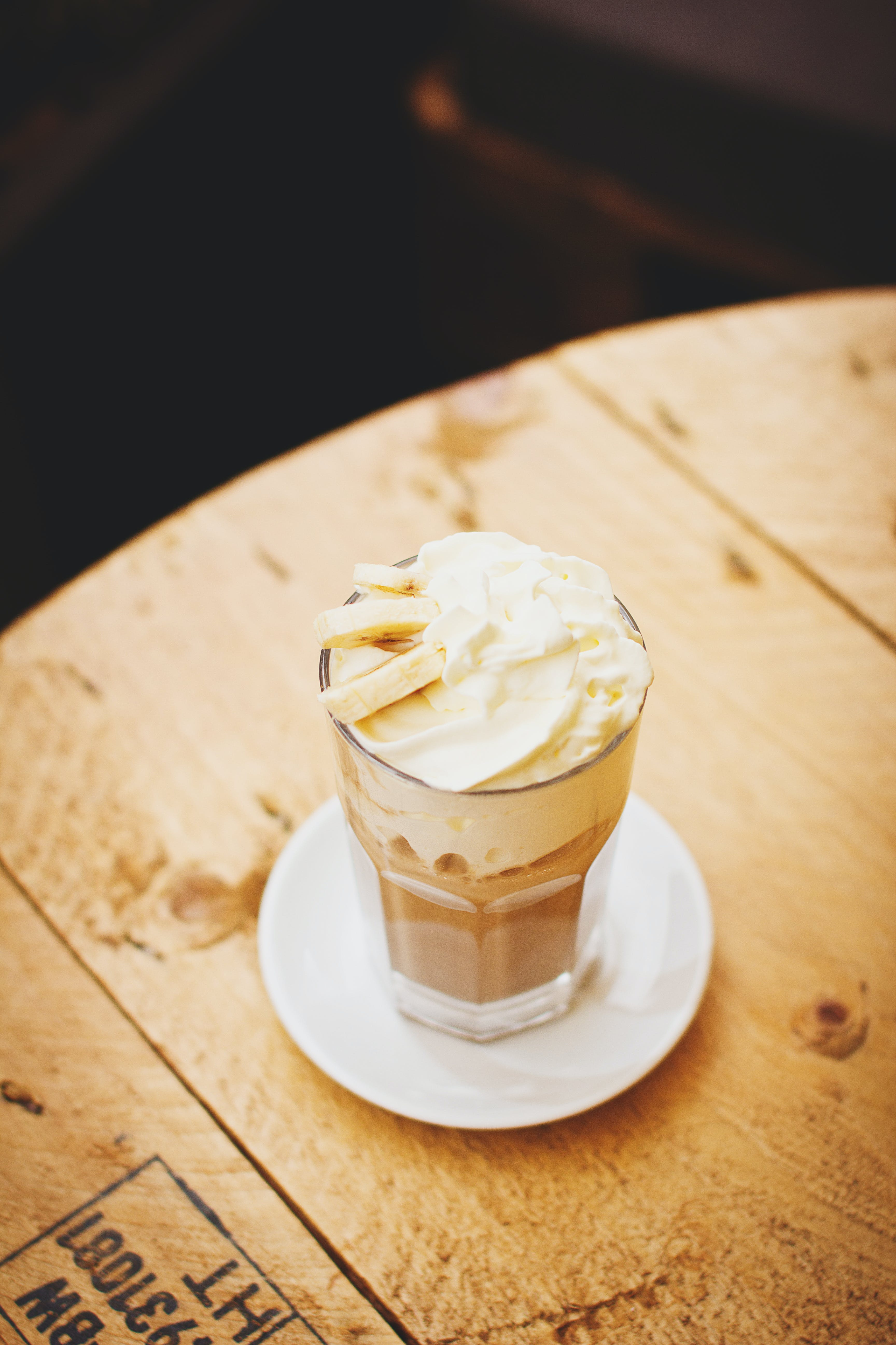 Photo of Clear Glass Cup With Whip Cream on Top Place on Saucer