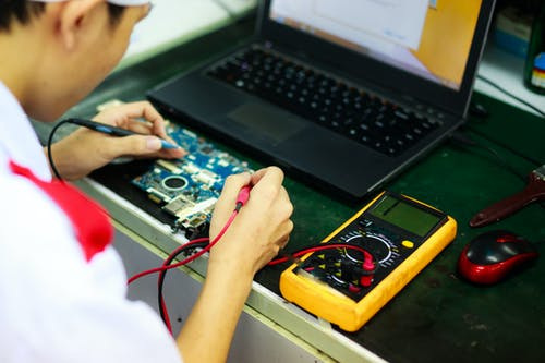 Man Soldering a Circuit Board