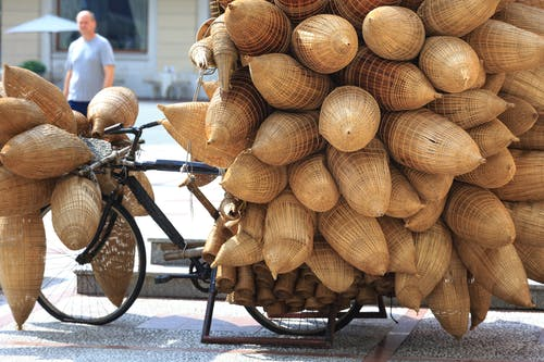 Bicycle Loaded With Brown Sacks