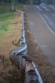 Wooden Small Fences Along the Road