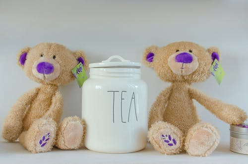 Two Bear Plush Toy Beside Tea Jat