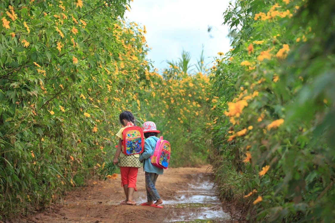 Photo Of Kids Walking On Dirt Road
