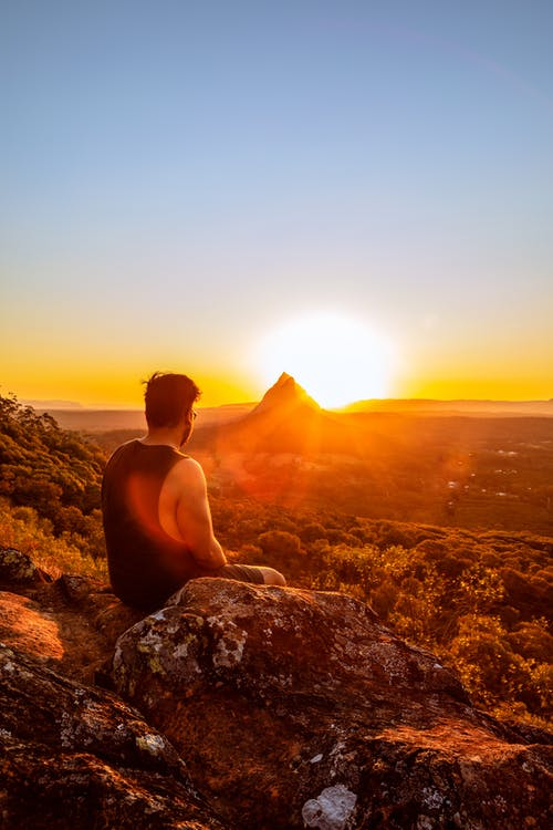 Man Sitting in Front of Mountain Views