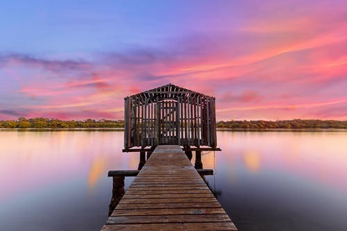 Brown Wooden Dock on Calm Body of Water