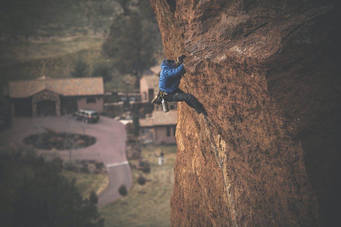Man Rock Climbing on Cliff