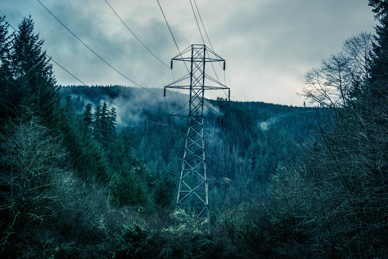 Gray Power Line Under Cloudy Sky