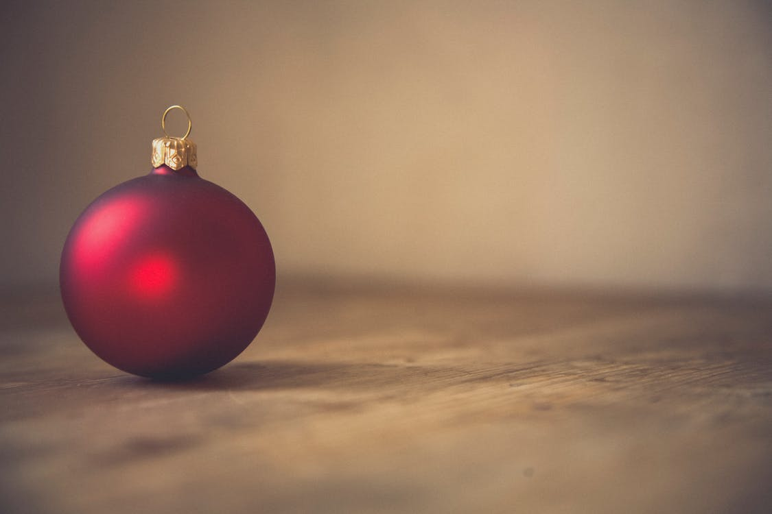 Red Bauble on Brown Sand