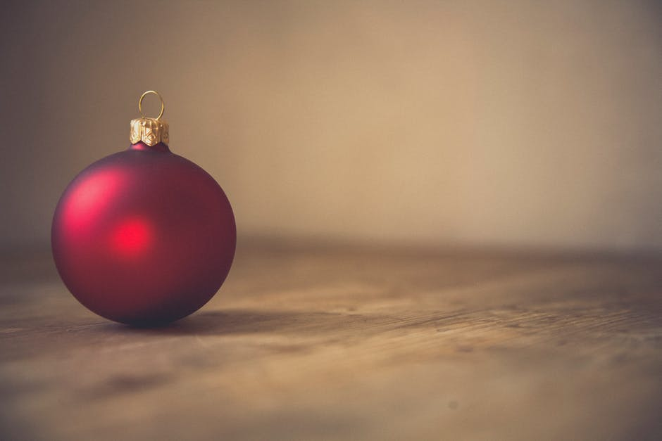 Red Christmas Bauble in Selective Focus Photography