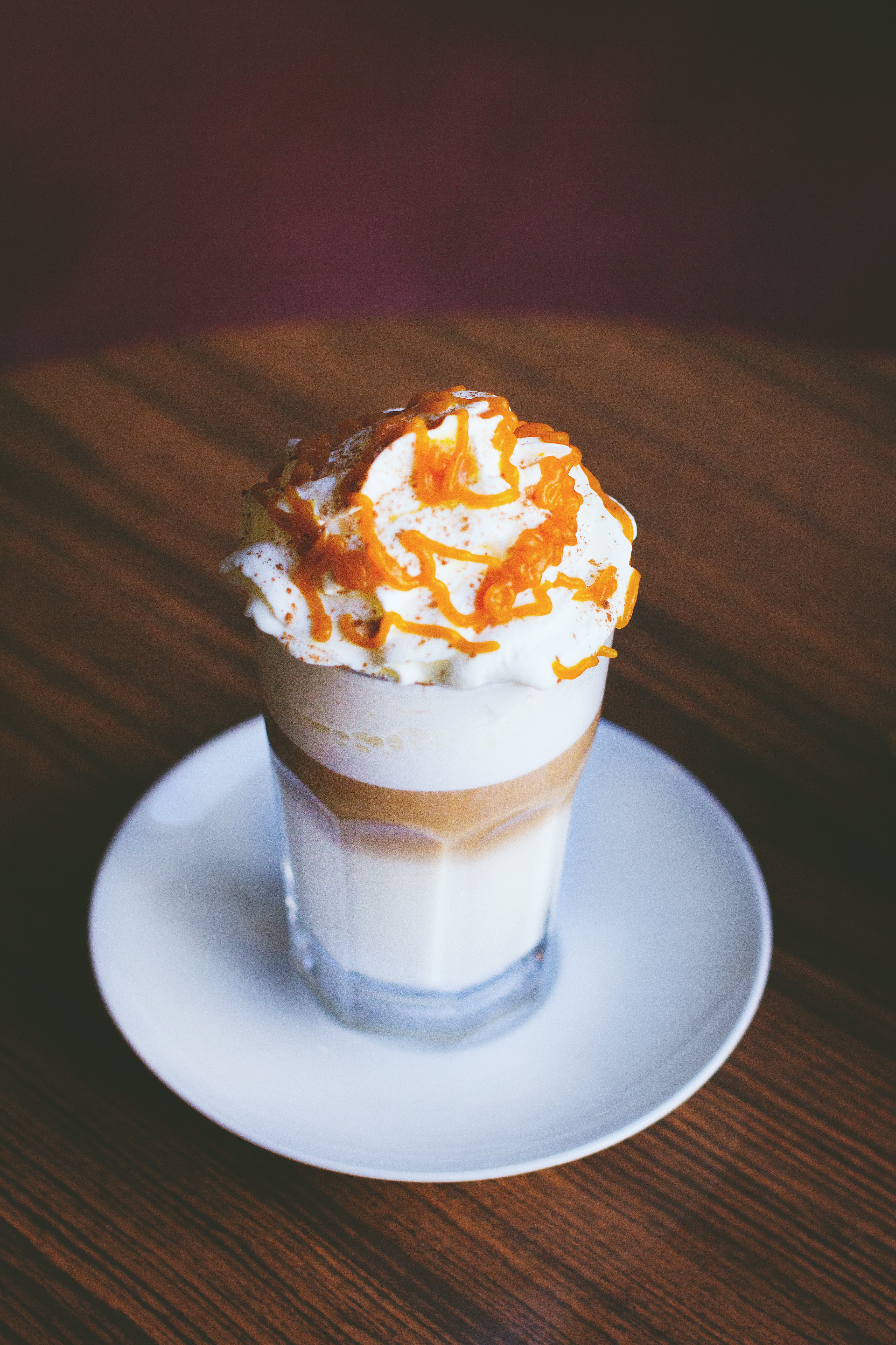 White and Brown Caramel Frappe on Clear Drinking Glass