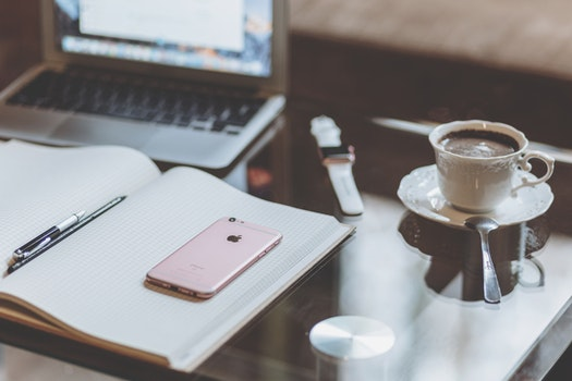 Rose Gold Iphone 6s on White Book Near Coffee