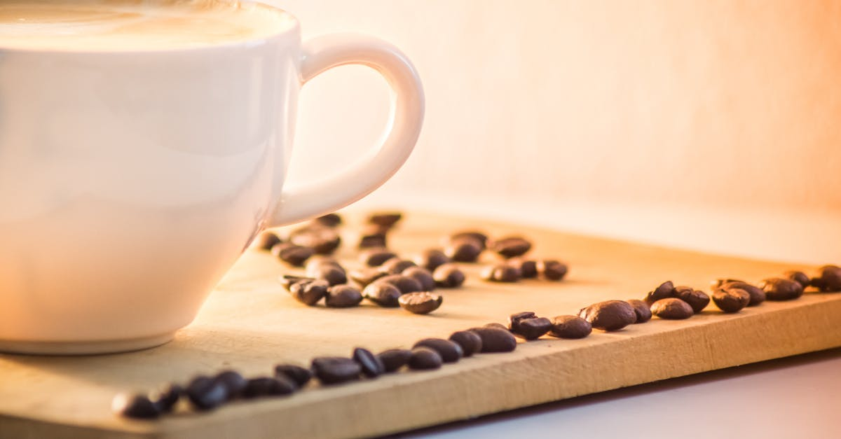 White Ceramic Coffee Mug With Cream Beside Black Coffee