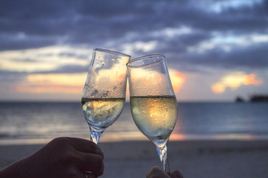 Two People Toasting Flute Glasses