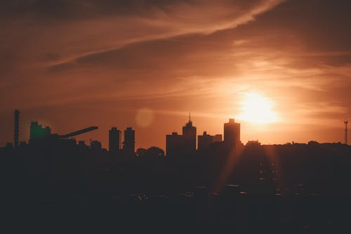 Gratis arkivbilde med by, sol, solnedgang