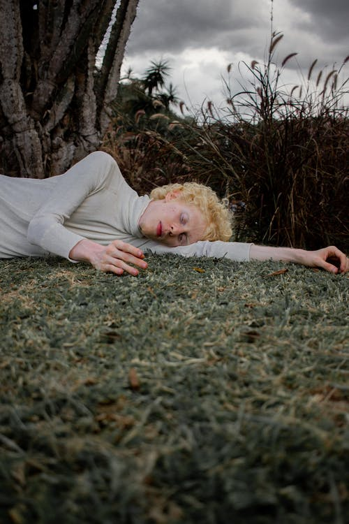 Photo Of Man Laying On The Ground
