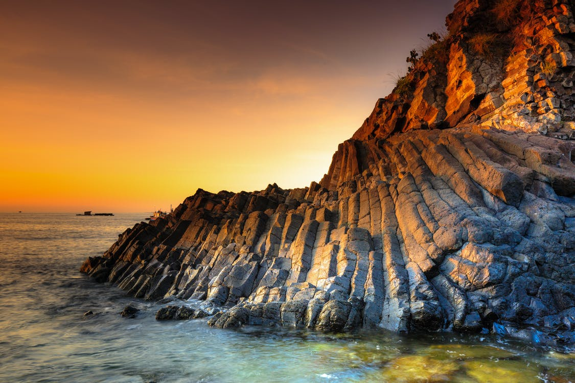 Photo of Rock Formation On Ocean