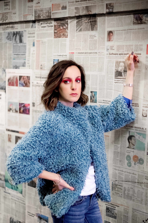 Woman Standing Wearing Blue Fur Coat