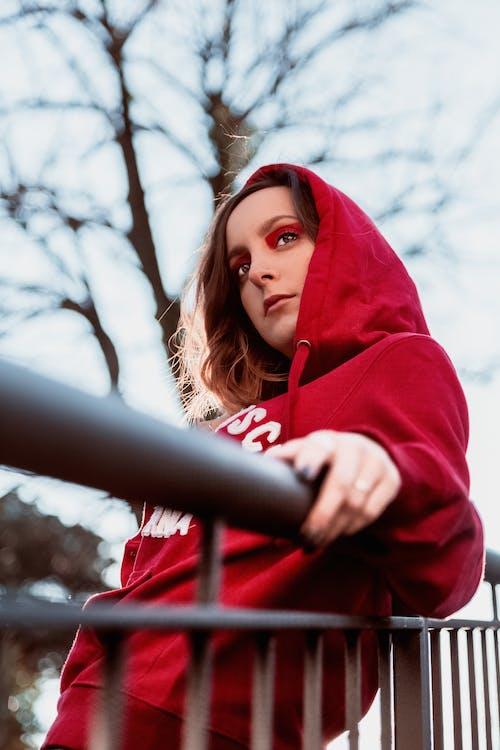 Photo Of Woman Wearing Red Hoodie
