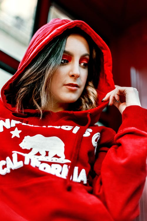 Close-up Photo of Woman in Red Hoodie