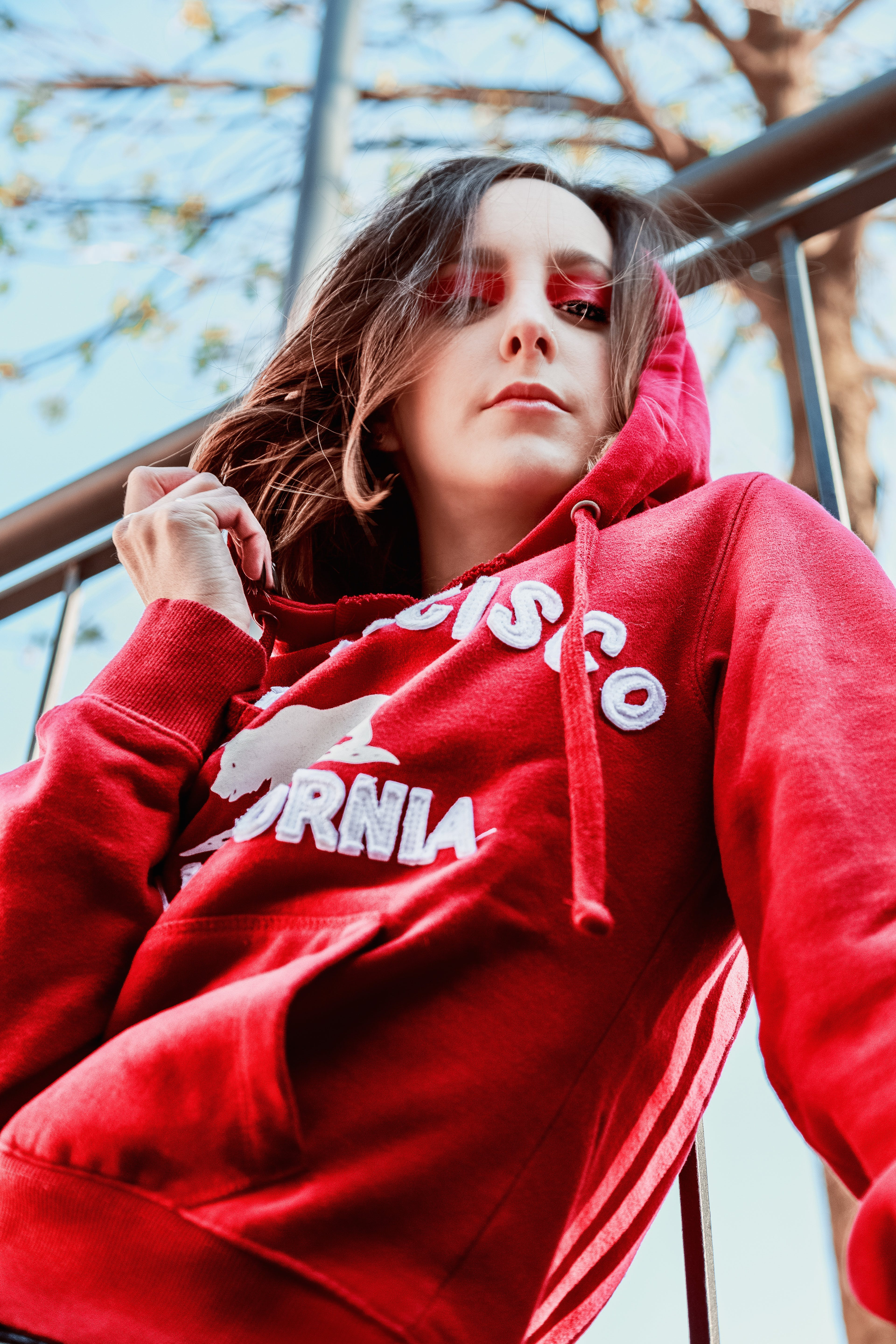 Low Angle Photography of Woman Wearing Red Hoodie