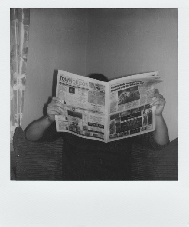Grayscale Photography Of Man Reading Newspaper