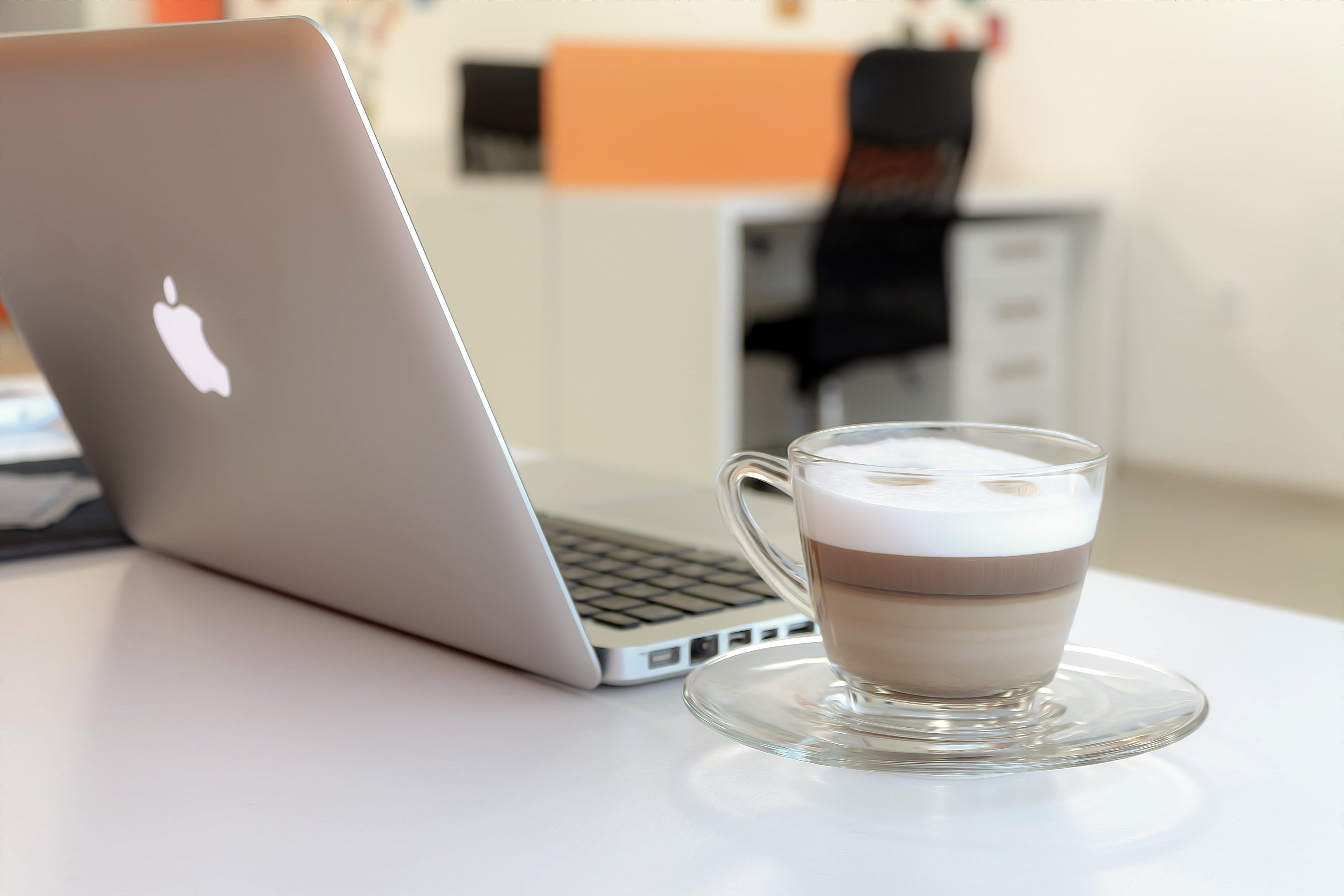 Macbook Pro Besides Clear Glass Mug