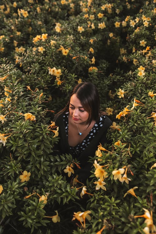 Woman Surrounded by Yellow Flowers