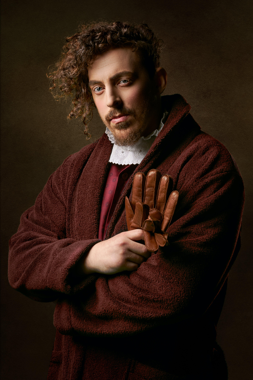Man Holding Glove